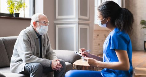 Young,Woman,African,Doctor,Give,A,Consultation,To,Elderly,Old